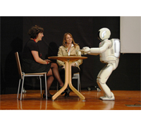 ASIMO demonstrates its ability to deliver drinks and carry a tray at the Genoa Science Festival in Italy. This is the first time the latest version of Honda's humanoid robot has been to Italy. It's spending 10 days appearing in a number of shows allowing the festival's visitors to see its range of current cutting-edge abilities first hand.