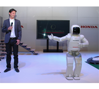 ASIMO greets Olympic show jumping gold medalist, and Honda's recently appointed ambassador in Switzerland, Steve Guerdat at the opening party of Auto Zurich Car Show