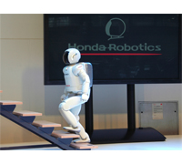 ASIMO demonstrates its ability to climb stairs at the opening party of Auto Zurich Car Show.