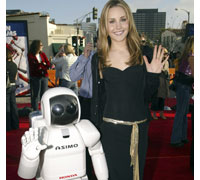 "ASIMO, the world's most advanced humanoid robot, with actress Amanda Bynes at the premiere of ""Robots."""