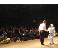 ASIMO traveled to Italy to appear in the opening ceremony of Futuro Remoto, the largest science festival in Southern Italy. After the opening ceremony ASIMO appeared in a show lasting 25 minutes, allowing the guests to see its range of cutting-edge abilities and the latest advances in the field of humanoid robotics first hand. This included ASIMO's ability to run, climb stairs, give and receive objects and interact with people.