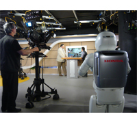Bultraco Honda Executive Director Kostadin Grozdanov interviewed at Nova TV.  ASIMO brings them drinks.