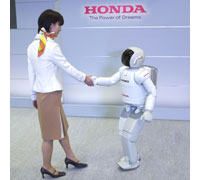 ASIMO can now move in synch with a person and move forward and backward in response to being pulled or pushed.