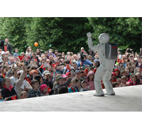 Crowds gather to watch ASIMO at Europe's largest open air science festival.