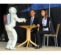 ASIMO serves His Excellency, Japanese Ambassador Yuichi Kusumoto a drink at Europe's largest open air science festival.