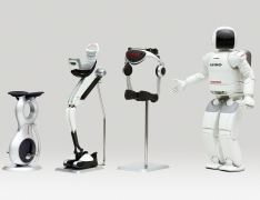 Honda's robotics technology (Left to Right): U3-X, Bodyweight Support Assist Device, Stride Management Support Assist Device, ASIMO humanoid robot.