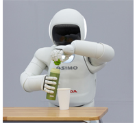 ASIMO opens a water bottle.